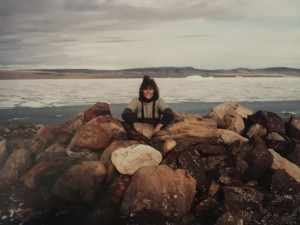 Nora sitting atop ancient Thule ruins on Ellesmere Island